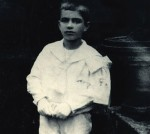 Celso Emilio is dressied up with First Communion suit. Celanova, 1920